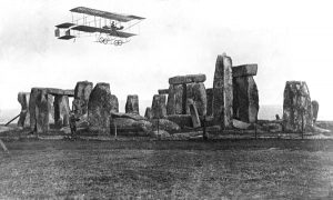 Postcard showing a Bristol Boxkite flying over Stonehenge on Salisbury Plain